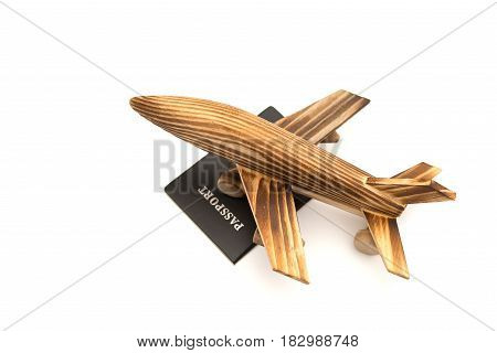 top view airplane model on top of a passport on white background