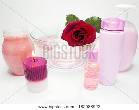 spa hair mask creme liquid soap candles essenses and red rose
