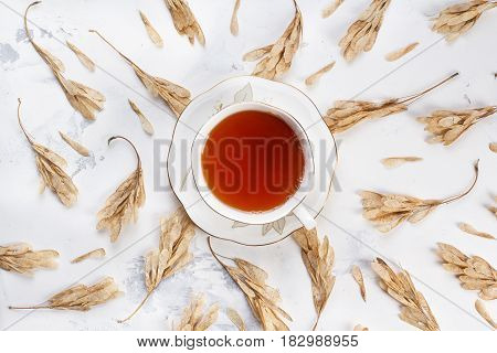 Cup of tea on white texture background