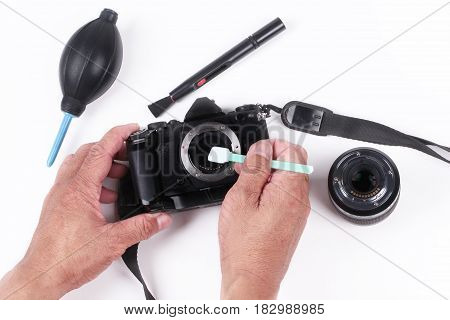 Mirrorless Sensor cleaning and MaintenancePhotographer hand cleaning sensor of camera by using sensor swab and vacuum pumpcleaning dirty camera sensor (CCD or Cmos)