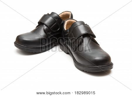 pair of black leather shoe for children on white background