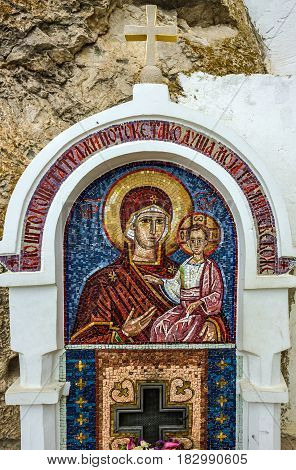 Ostrog, Montenegro - April 10, 2017: Virgin Mary - mosaic icon in rocky Serbian Orthodox Christian monastery Ostrog in mountains of Montenegro. Ostrog - popular place of pilgrimage in Europe.