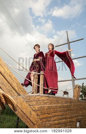Two ladies in retro clothes on a boat. Luxury and glamour