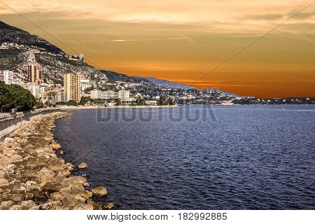 Monaco and Monte Carlo principality seafront sunset view.