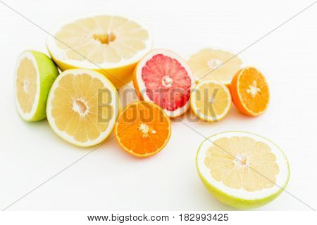 Tropical mix with fresh lemon, orange, mandarin, grapefruit and sweetie on white background. Flat lay, top view.