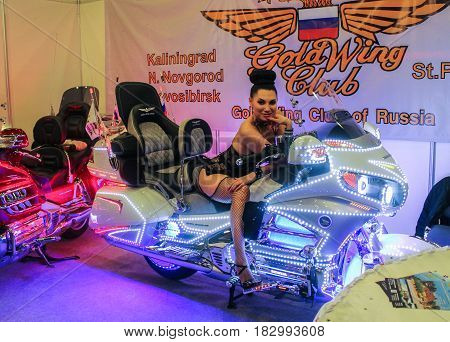 St. Petersburg Russia - 15 April, A model on a neon motorcycle,15 April, 2017. International Motor Show IMIS-2017 in Expoforurum. Models on motorcycles presented at the motor show.