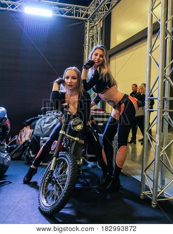 St. Petersburg Russia - 15 April, Fashion models on a motorcycle,15 April, 2017. International Motor Show IMIS-2017 in Expoforurum. Models on motorcycles presented at the motor show.
