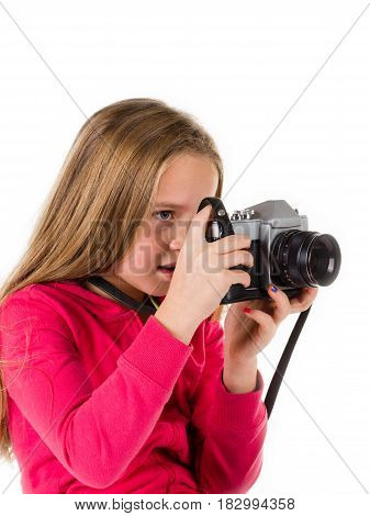 Little girl with an old camera isolated on a white background. Concepts : photography retro tourism lifestyle. Concepts : photography retro tourism lifestyle. Studio portrait shot