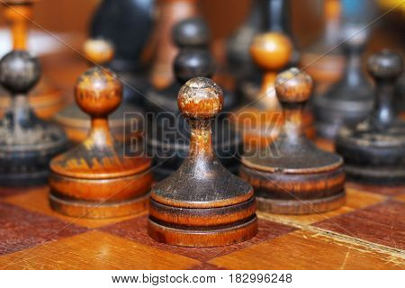 Old wooden chess on a chessboard retro style