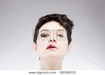 Half Make Up On A Girl With Short Hair