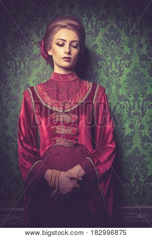 Beautiful Gorgeous woman dressed vintage clothes in retro interior. Rococo period. Luxury and high class