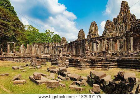 Prasat Bayon is surrounded by tropical trees Siem Reap, Cambodia. Ancient Khmer temple with frescoes and columns, World Heritage