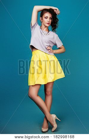 Fashion photo of young model woman on green background. Girl posing. Studio photo.