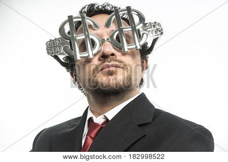Investment, Businessman with suit and glasses in the form of dollars. Expressions of stress, overwhelm and craving for money
