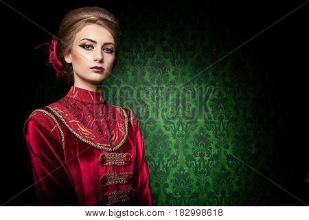Gorgeous woman dressed vintage vogue clothes in retro interior. Rococo period. Luxury and high class