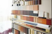 Furniture fittings multicolored chipboard panels close-up background laminated chipboards color palette texture furniture sample parquet boards in hardware store in home improvement warehouse exterior poster