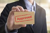 Businessman holding paper writed approved. The flowchart is approved QC and policy for sign symbol passed. poster