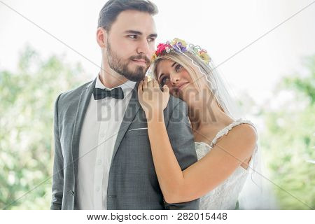 Young Couple In Love Wedding Bride And Groom Embracing Together And Looking At Each Other Kissing In