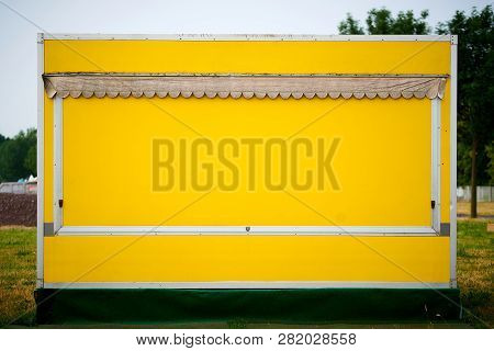Yellow Stall For Fruits And Vegetables On The Roadside