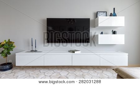 Moscow - June 18, 2018: Modern Home Interior With Tv And Flower. Light Interior Design Of Living Roo