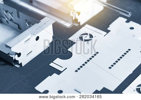 The Sheet Metal Work Pieces In The Light Blue Scene. Sheet Metal Working Manufacturing Process.