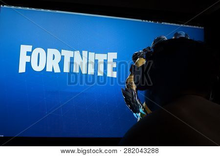Tula, Russia - January 27, 2019 - Fortnite Video Game Screen With Character And Console Controller.