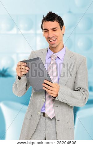 Portrait of young businessman standing with touch screen computer