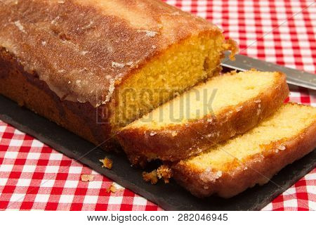 Homemade Lemon Drizzle Cake A Slice Of Freshly Made Lemon Drizzle Cake