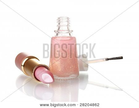 Pink lipstick and beige nail polish with sparkles isolated on white