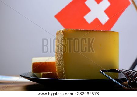 Block Of Swiss Hard Cheese Appenzeller Used For Traditional Fondue And Gratin And Flag Of Switzerlnd