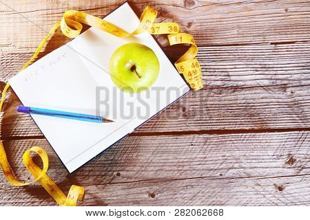 Blank Open Notebook With Green Apple And Yellow Centimeter Tape. Concept Sport, Diet, Fitness, Healt