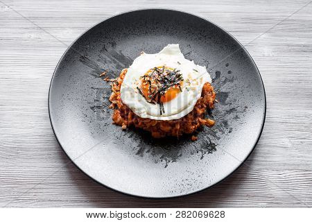 Korean Cuisine - Above View Of Kimchi Bokkeum Bap (fried Rice With Kimchi, Beef And Fried Egg) On Bl