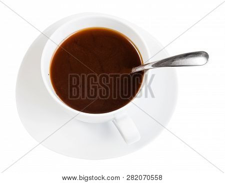 Top View Of Hot Black Coffee Drink In White Porcelain Cup With Spoon On Saucer Isolated On White Bac
