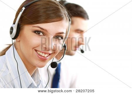 Friendly customer service consultants working, focus on a young girl
