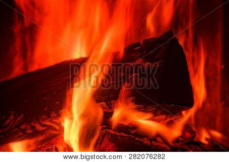 Close-up Of Wood Burning In A Stove