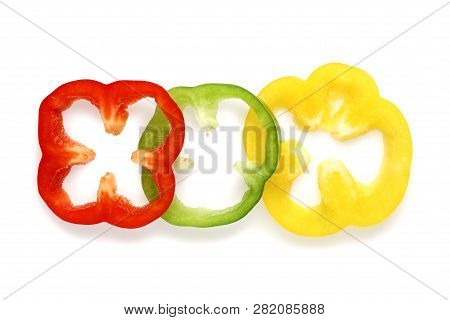 Sliced Colorful Bell Peppers Isolated On White