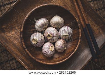 Still Life Of Chinese Garlic In A Wooden Bowl
