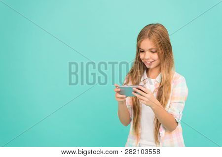 Pretty Blogger. Small Girl Child With Smartphone. Small Girl Using Mobile Phone. Adorable Child Lear