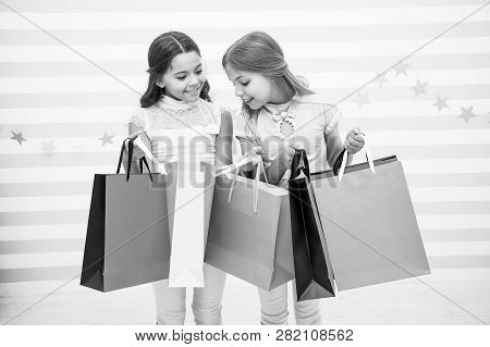 Shopping With Best Friend Concept. Girls Like Shopping. Kids Happy Small Girls Hold Shopping Bags. E