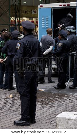 NEW YORK - NOV 17:  Unidentified people arrested at Broad & Beaver Streets on November 17, 2011 in New York City, NY. Dubbed 'Day of Disruption', today marks 2 months since the OWS movement began.