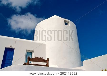 House In Mykonos, Greece. Whitewashed Building On Sunny Blue Sky. Typical House Architecture And Des