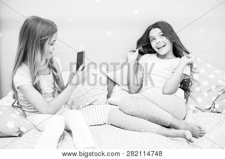 Girlish Leisure Pajama Party. Girls Smartphone Posing Great Shot. Send Photo Social Network Using Sm
