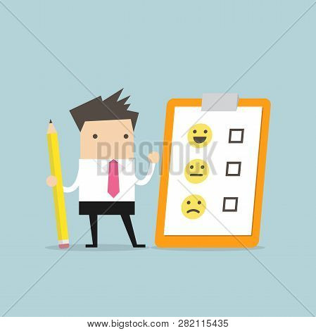 Businessman Holding Pencil And Paper Of Checklist Feedback On Clipboard. Customer Evaluation. Feedba