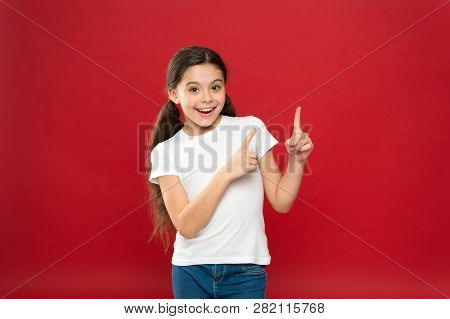 Young And Free. Happy Child Girl With Long Hair On Red Background. Happiness And Joy. Positive Emoti