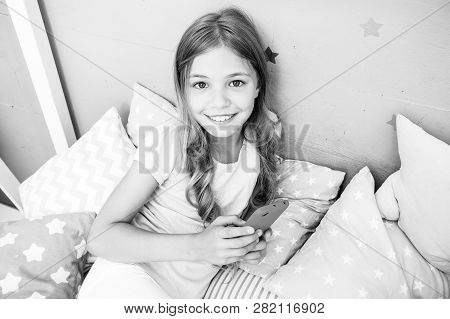 Activities For Pajama Party. Girl Kid Wear Pajama Hold Smartphone. Child In Pajama Hold Smartphone.