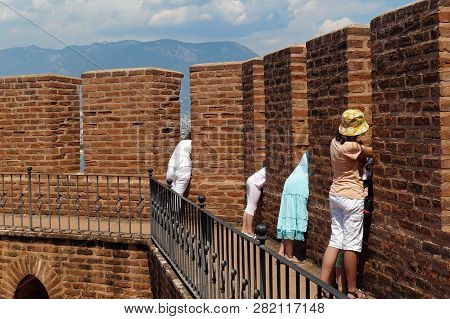 It Is So Interesting Out There Tourists Looking Through The Embrasures Of Ancient Red Tower In Alany