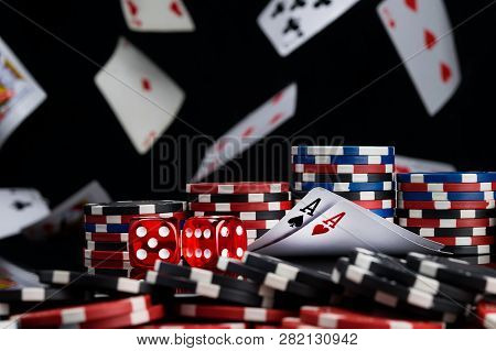 The Concept Of Chips And Cards For Playing Poker On The Background Of A Flying Cards