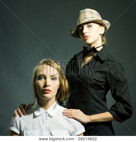 Fashion Static Portrait Of Two Beautiful Women Looking In Camera