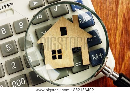 House Value. Model Of Home, Calculator And Magnifying Glass.