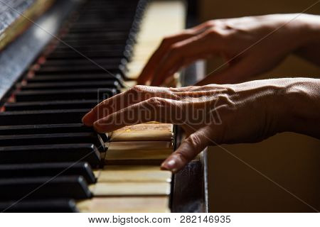 Close Up Fingers Of Woman Pianist At The Rusty Piano Keys, Arms Plays Solo Of Music. Hands Of Female